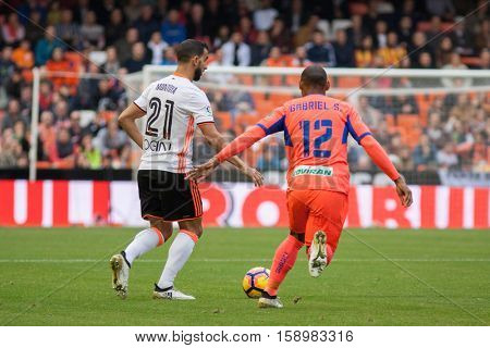 VALENCIA, SPAIN - NOVEMBER 20th: 21 Montoya, 12 Gabriel during La Liga soccer match between Valencia CF and Granada CF at Mestalla Stadium on November 20, 2016 in Valencia, Spain