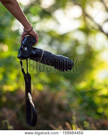 Travaler woman hand holding camera, select focus