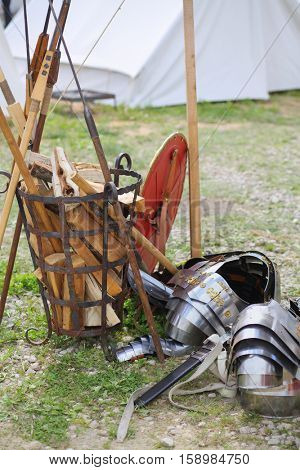 MOSCOW - JUN 06, 2015: Equipment shield Roman soldier on the grass near the forged baskets of firewood at the festival Times and epoch: Ancient Rome in Kolomenskoye