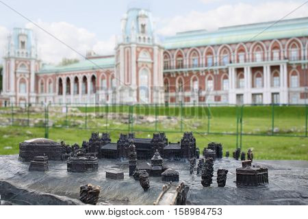 MOSCOW - JUN 06, 2015: Bronze miniature palace and park ensemble Tsaritsyno in front of the manor building, focus on the miniature