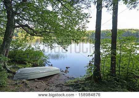 Boat on the Shore of MIrror Lake in Porcupine Mountains State park in Michigan