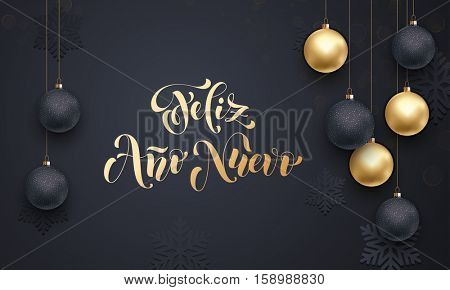 Spanish Happy New Year Feliz Ano Nuevo golden decoration ornament with Christmas ball on vip black background with snowflake pattern. Premium luxury Christmas holiday greeting card. Gold calligraphy