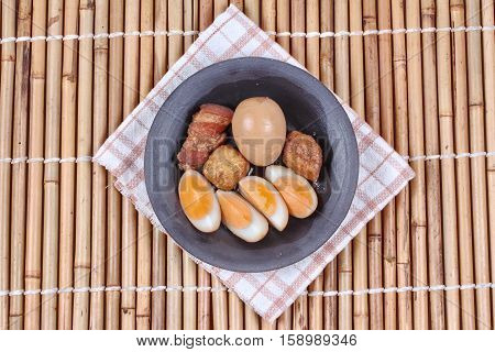 Ready stewed boiled egg with tofu and streaky pork served as Khai Phalo in Thai.