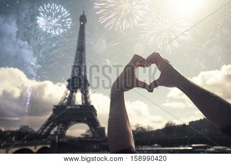 Eiffel tower (Paris, France) with fireworks - Celebrating New Year in the city