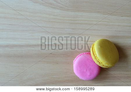 Colorful French Macaron Cookies On Wooden Board
