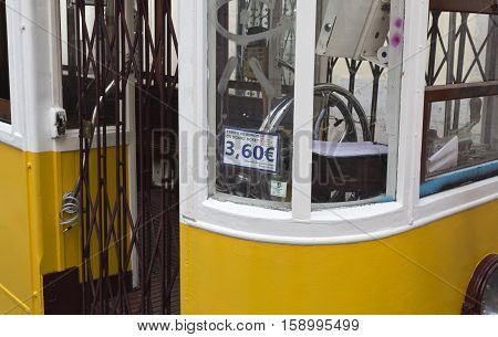 LISBON, PORTUGAL - October 1, 2016: Detail of the tram entry steering wheel and the exorbitant fare of a minute journey down the street in Lisbon Portugal