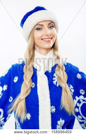 Portrait of a Snow Maiden in a blue suit. Beautiful white girl with long blond hair braided in pigtails. She smiles. Face makeup. Isolated on white background.