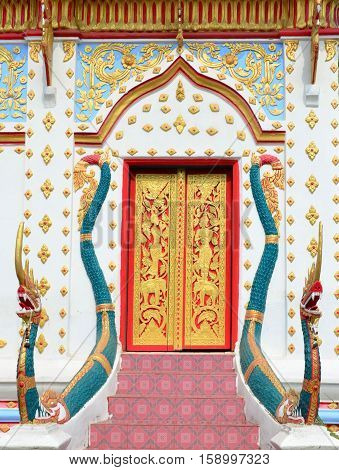 Beautiful Red And Gold Thai Church Entrance With Green Serpent