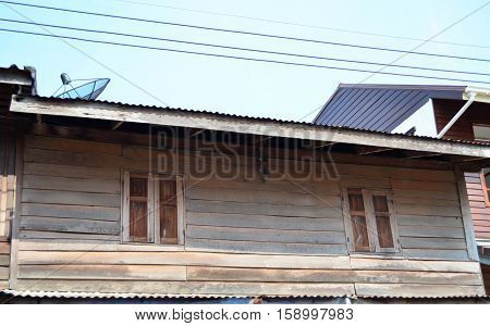 Old Wooden House With Satelite And Electric Wire