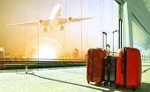stack of traveling luggage in airport terminal building and passenger plane flying over urban scene poster