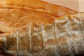 smoked trout closeup of fillet and scale sides poster