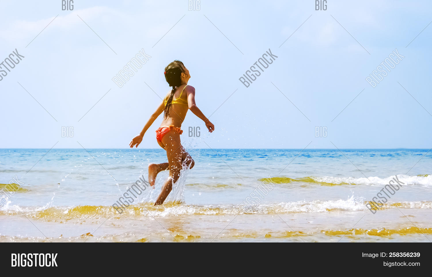 1a42f152b1af7 Summer fun beach woman splashing water. Panorama landscape of tropical  ocean on travel holiday. Bikini girl running in freedom and joy with hands  up ...