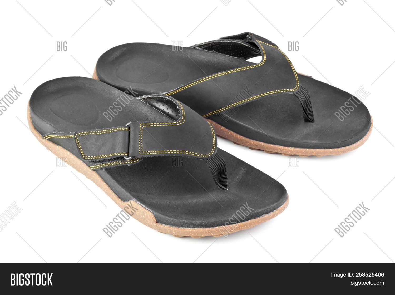 8b5dc2e8491c Pair Of Black Flip Flops Isolated On White Background