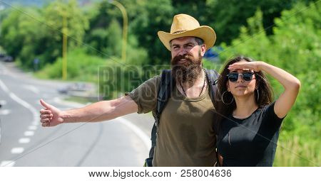 Hitchhiking Is One Of Cheapest Ways Of Traveling. Couple Hitchhikers Travelling Summer Sunny Day. Co