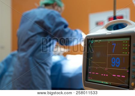 Electrocardiogram In Hospital Surgery Operating Emergency Room Showing Patient Heart Rate With Blur