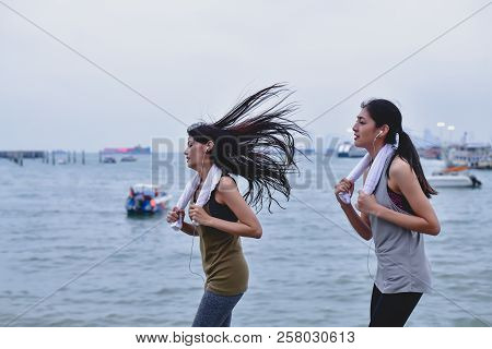 Sports Concept. Beautiful Girl Is Exercising On The Beach With Running. Beautiful Girl Is Happy To E