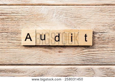 Audit Word Written On Wood Block. Audit Text On Table, Concept.