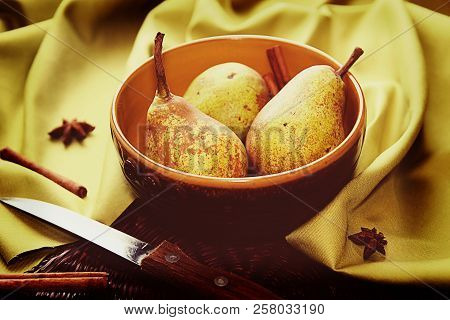 Homegrown Pears From Rural Garden In Ceramic Bowl On Napkin And Cinnamon Sticks And Stars Aniseed Tr