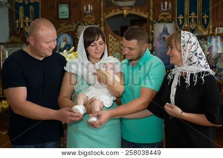 Belarus, Gomel, On June 14, 2018. Zyabrovskaya Church. Baptism Of The Child. Parents And Godparents