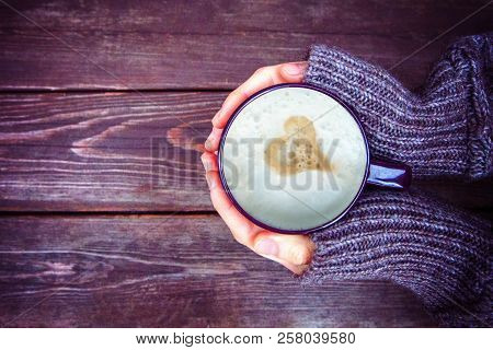 Woman Holds Hot Cup Of Coffee Latte, Cappuccino With Milk Cream And Heart (valentine, Love), Warming