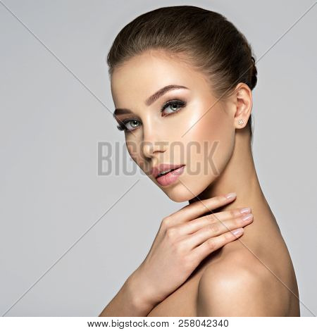 Closeup face of sexy beautiful young woman. Beauty treatment concept. Portrait of a pretty  caucasian girl with healthy skin.