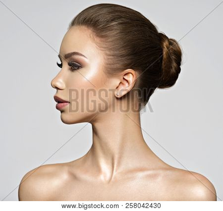 Beautiful young woman - profile view. Beauty treatment concept. Portrait of a pretty  caucasian girl with healthy skin.