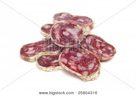 a pile of slices of fuet, a typical spanish salami