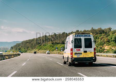 Vilafreser, Spain - May 18, 2018: Emergency Ambulance Van Iveco Car Moving On Spanish Motorway Road