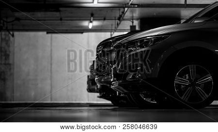 Car Parking In Shopping Mall Underground Parking Lot. Indoor Car Parking. Black And White Scene Of C