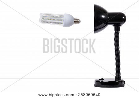 Led Lamp In Off Position With Black Lamp Holder. White Background