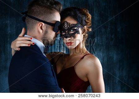 Sexy Woman Female In Black Carnaval Mask Red Expensive Dress And Gold Earnings Seduces Millionaire M