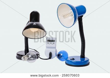 Led Lamp Illuminated With Lampholder Replaces The Old Obsolete Light Bulbs. An Energy Meter Calculat