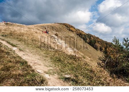 Kozi Chrbat Hill In Starohorske Vrchy Mountains With Mountain Meadow,relaxing People, Colorful Fores