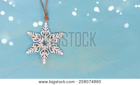 Christmas Star On Blue Wooden Background With Copy Space Banner With Copy Space