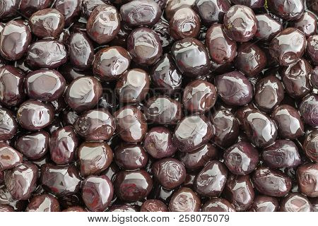 Tasty Brine Cured Grade A Mediterranean Black Olives In A Close Up Full Frame View For A Healthy App