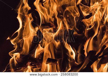 Fire Flames Close Up Photo. Beautiful Natural Phenomen Of Dangerous Burning Wood.