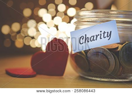 Charity Money Jar With Blurred Lights, Closeup