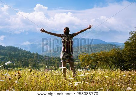 Freedom in vacation.Traveler with backpack in vaaction conquer nighest peak Woman in vacation traveling alone in nature. Vacation lifestyle. Mountain landscape. Vacation. Traveler. Travel Lyfestykle. Nature. Outdoor. Travel lifestyle concept.