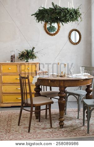 Dining Table With Candlesticks And Glasses Prepared For Celebration With Christmas Conifer Garland H