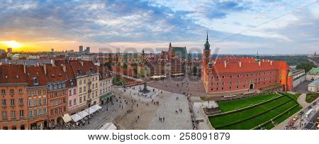 Panorama of the Royal Castle square in Warsaw city at sunset, Poland