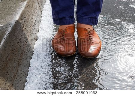 View On Wet Shoes Standing Near Hailstones After Hailstorm
