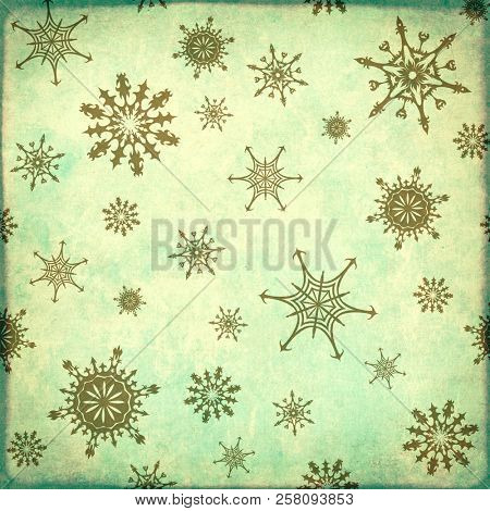 Texture of old, soiled paper of blue color and snowflakes pattern. Can be used for winter or Christmas design, wallpaper, pattern fills, web page background, surface textures