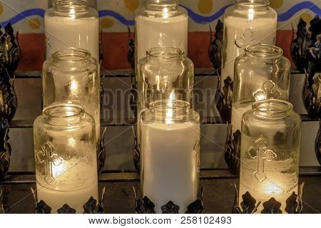 Burning Votive Candles In A Church. Mission Soledad, California, Usa.
