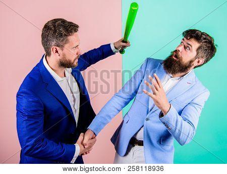 Threat With Violence. Hidden Threat Concept. Businessman Raise Bat While Shaking Hands. Business Par