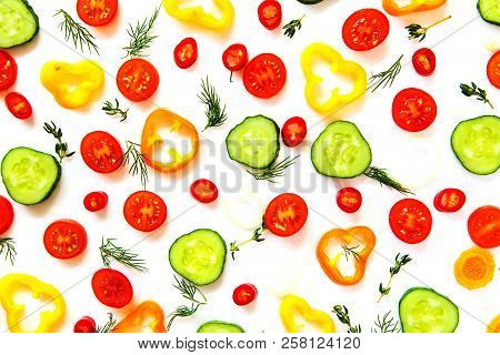Collection Of Sliced Vegetables And Herbs.