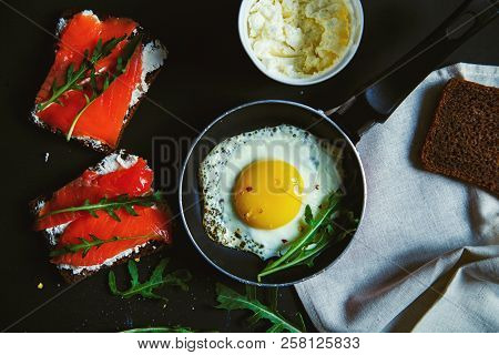 Fried Egg And Sandwiches With Cream Cheese, Salmon And Arugula.