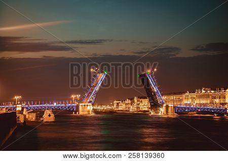 Divorce Of Bridges In St. Petersburg. Night City Of Russia. The Neva River