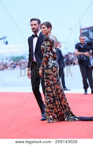 Alex Belli and Mila Suarez walk the red carpet ahead of the 'One Nation One King (Un Peuple Et Son Roi)' screening during the 75th Venice Festival at Sala Grande on September 7, 2018 in Venice, Italy