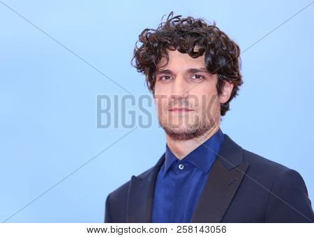 Louis Garrel walks the red carpet ahead of the 'One Nation One King (Un Peuple Et Son Roi)' screening during the 75th Venice Film Festival at Sala Grande on September 7, 2018 in Venice, Italy.