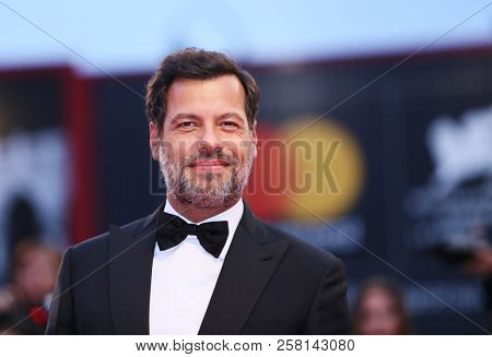 Laurent Lafitte walks the red carpet ahead of the 'One Nation One King (Un Peuple Et Son Roi)' screening during the 75th Venice Film Festival at Sala Grande on September 7, 2018 in Venice, Italy.
